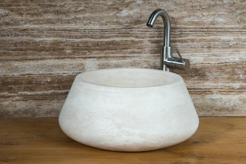 lavabo da appoggio in pietra chiaro sinuoso rotondo